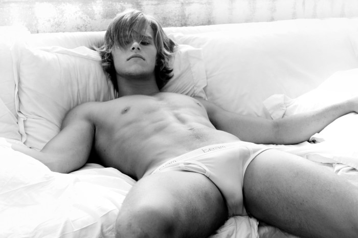 sexy guy on sofa